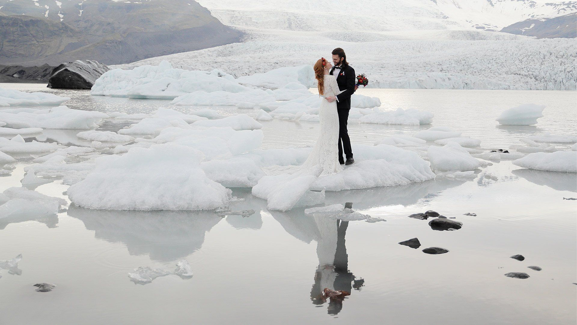 Eloped couple during ceremony on ice in Iceland shot on Canon EOS R & RF 24-105mm f/4L IS USM